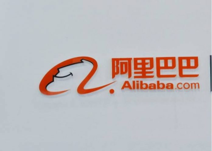 (FILES) This file picture taken on September 9, 2014 shows a woman walking past the Alibaba booth during an exhibition in Hangzhou, east China's Zhejiang province. Alibaba co-founder and chairman Jack Ma announced on September 10, 2018, he would step down as leader of the pioneering Chinese e-commerce giant in one year but stressed that a planned leadership transition would not break the company's stride. Ma will stay on as executive chairman until September 10, 2019 before handing over his role to chief executive officer Daniel Zhang, Alibaba said in a statement. / AFP PHOTO / STR / China OUT