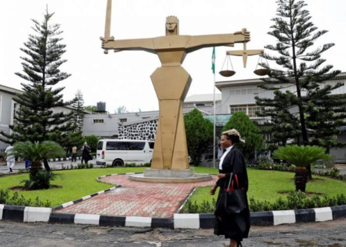 A lawyer walks through the compound at the Federal High Court in Ikoyi district in Lagos, Nigeria, May 8, 2018. REUTERS/Akintunde Akinleye
