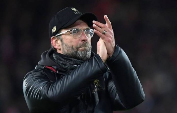 Liverpool's German manager Jurgen Klopp applauds supporters on the pitch after the English Premier League football match between Liverpool and Leicester City at Anfield in Liverpool, north west England on January 30, 2019. – The game finished 1-1. (Photo by Paul ELLIS / AFP) /