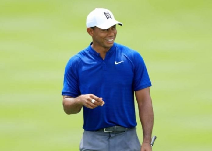 AKRON, OH - AUGUST 02: Tiger Woods reacts after making birdie on the 18th green during World Golf Championships-Bridgestone Invitational - Round One at Firestone Country Club South Course on August 2, 2018 in Akron, Ohio. Sam Greenwood/Getty Images/AFP